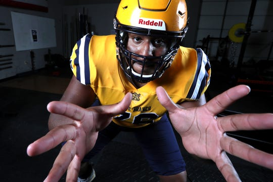 Oliver Branch's Xavier Hill is No. 8 in the Commercial Appeal's inaugural Dandy Dozen, a collection of the top college football prospects in the Mid-South.