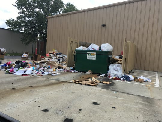 Trash overflows outside a Family Dollar store at 6222 Winchester Road.