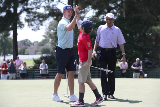 Justin Rose shares putting duties with Dakota, 13, to win a $50,000 check from FexEx Cares for St. Jude Hospital at the WGC-FedEx St. Jude Invitational at TPC Southwind on Wednesday, July 24, 2019.