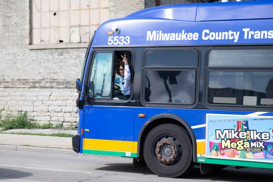 A bus driver honks her horn and gives a peace sign during a rally hosted by Amalgamated Transit Union Local 998 for concerns about safety of drivers and passengers in front of the Fond du Lac Operating Station in Milwaukee, Wisconsin on Thursday, July 18, 2019.