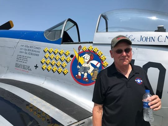 Tony Buechler of Waukesha stands next to his P-51 Mustang painted in the colors and configuration of the commander of the 487th Fighter Squadron during World War II. Buechler has flown his P-51 to EAA AirVenture in Oshkosh for each of the 34 years he has owned the plane.