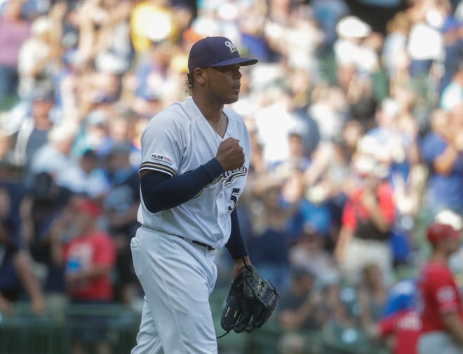 Brewers relief pitcher Freddy Peralta Pumps his fist after getting the final out in the ninth inning Wednesday.
