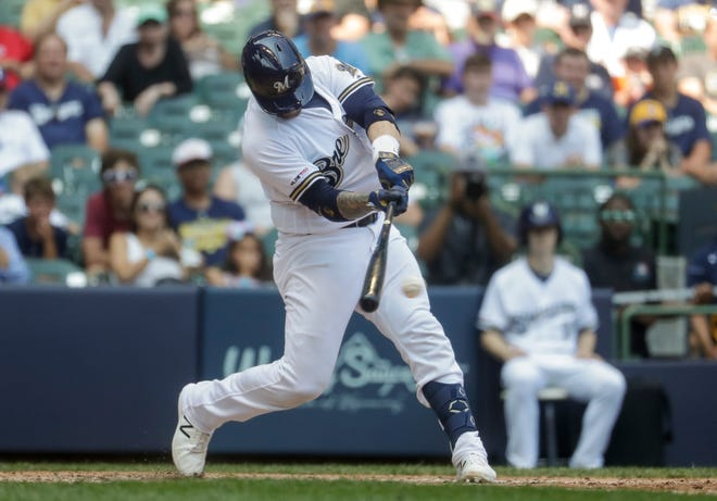 Brewers catcher Yasmani Grandal connects on a two-run single Wednesday afternoon.