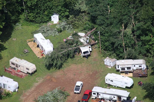This image shows two trees collapsed onto an RV in northwest Wisconsin.