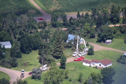 Utility crews work to restore power in northwestern Wisconsin this week in this aerial photo from the Wisconsin State Patrol.