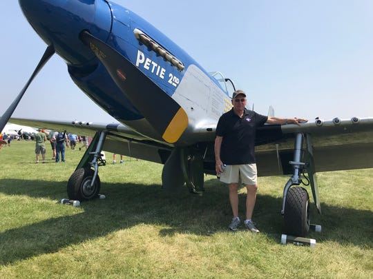 Tony Buechler of Waukesha stands next to the P-51 Mustang he has owned for 34 years. Buechler is flying his Mustang during EAA AirVenture in Oshkosh.