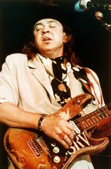 Blues guitarist Stevie Ray Vaughan is seen performing onstage at the Rhythm and Blues Foundation Benefit in Austin, Texas, in this 1988 photo.