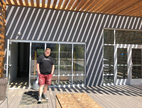 Nick Kocis, co-founder and brewer for Dead Bird Brewing, stands on the deck of the brewery in Halyard Park. The brewery expects to open in August.