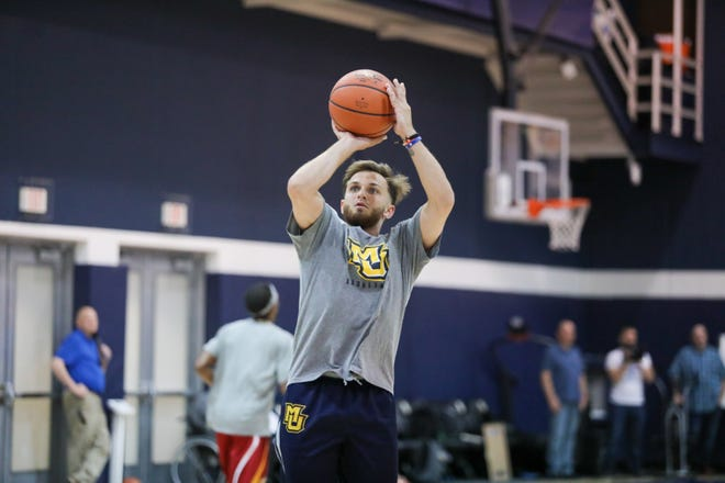 Andrew Rowsey puts up a shot during practice for the Golden Eagles' alumni team for The Basketball Tournament.