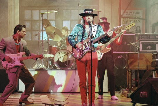 "Guitarist Stevie Ray Vaughan (center) rehearses for a performance on ""Saturday Night Live"" on Feb. 13, 1986. Bassist Tommy Shannon is at right. Guitarist Jimmie Vaughan is at left."