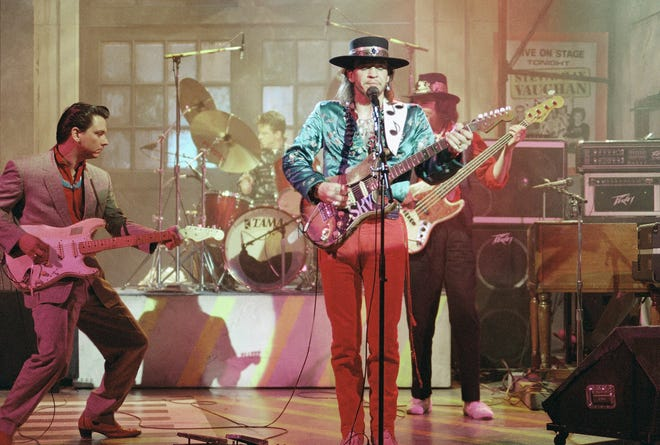 """Guitarist Stevie Ray Vaughan (center) rehearses for a performance on """"Saturday Night Live"""" on Feb. 13, 1986. Bassist Tommy Shannon is at right. Guitarist Jimmie Vaughan is at left."""