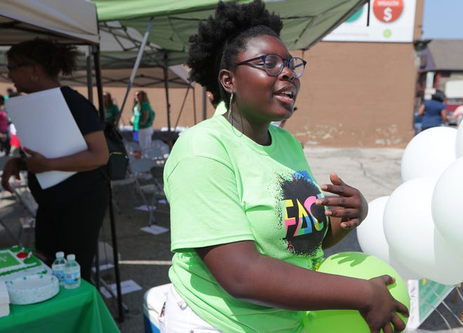 Nia Kamara, an ambassador for the anti-tobacco youth group FACT, raises awareness on the problems associated with the illegal sale of single cigarettes, known as loosies, last July.