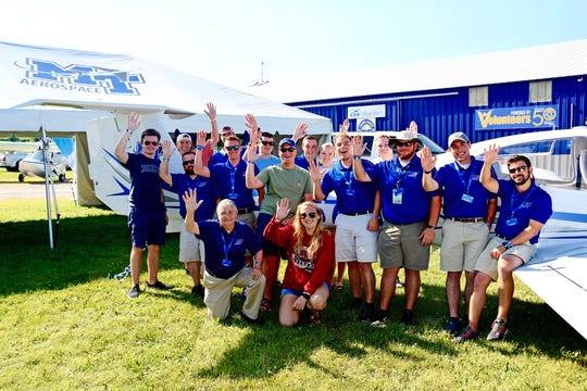 Students, alumni and flight instructors from MTSU's Department of Aerospace gather around a Diamond DA40 aircraft that the university flew to Oshkosh, Wis., for EAA AirVenture.