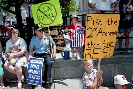 Activists of all ages and from several states turned up at an anti-gun-control rally in front of the War Memorial Building in downtown Nashville July 2, 1994. Clara, left, and Graham James of Florence, Ala. brought their grandchildren, Cody Powell, 4, and Ashlee Powell, 9, to show their support for the Second Amendment, which they feel is being eroded.