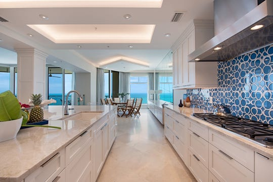 An oversized island with a quartzite countertop is one of the many features of the renovated kitchen.