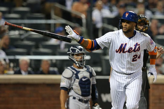 Jul 23, 2019; New York City, NY, USA; New York Mets second baseman Robinson Cano (24) tosses his bat after hitting a solo home run against the San Diego Padres during the fourth inning at Citi Field. Mandatory Credit: Brad Penner-USA TODAY Sports