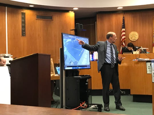 Defense attorney Paul Condon shows the jury video of the parking lot.