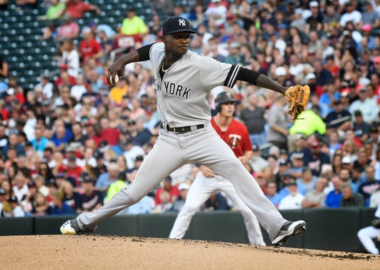 New York Yankees pitcher Domingo German throws against the Minnesota Twins in the first inning of a baseball game, Tuesday, July 23, 2019, in Minneapolis. (AP Photo/Tom Olmscheid)