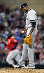New York Yankees pitcher Domingo German, right, kicks the rubber as Minnesota Twins Miguel Sano, left, rounds the bases with a three-run home run in the fourth inning of a baseball game, Tuesday, July 23, 2019, in Minneapolis. (AP Photo/Tom Olmscheid)