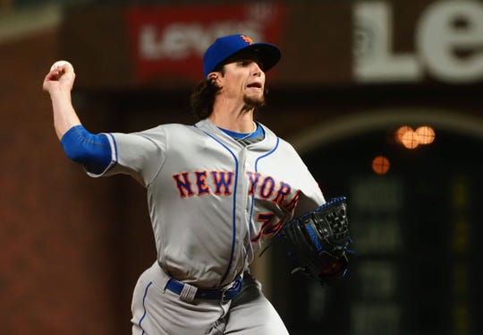 Jul 18, 2019; San Francisco, CA, USA; New York Mets relief pitcher Chris Mazza (74) pitches against the San Francisco Giants during the 16th inning at Oracle Park.