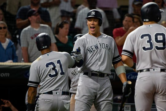 Jul 23, 2019; Minneapolis, MN, USA; New York Yankees outfielder Aaron Judge (99) congratulates outfielder Aaron Hicks (31) after his home run in the ninth inning against Minnesota Twins at Target Field. Mandatory Credit: Brad Rempel-USA TODAY Sports
