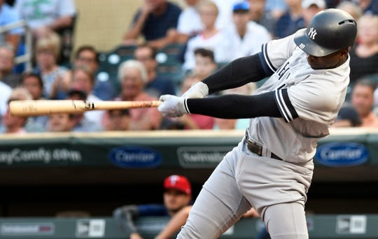 New York Yankees' Didi Gregorius doubles off Minnesota Twins pitcher Kyle Gibson driving in two runs in the first inning of a baseball game, Tuesday, July 23, 2019, in Minneapolis. (AP Photo/Tom Olmscheid)