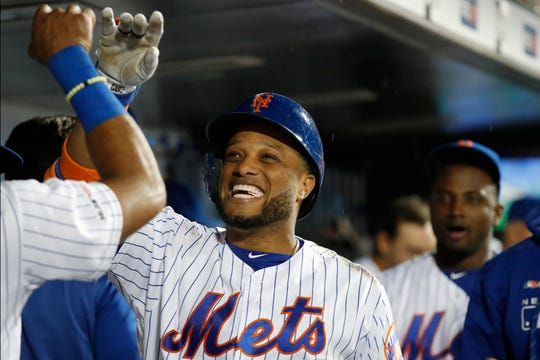 New York Mets' Robinson Cano (24) celebrates with teammates in the dugout after hitting the third of three home runs in a baseball game against the San Diego Padres, Tuesday, July 23, 2019, in New York. Two of the three homers were two-run shots with Pete Alonso scoring on both. (AP Photo/Kathy Willens)