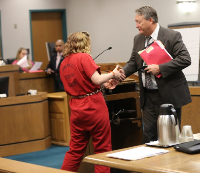 Brittney Ray Priddy, 29, of Ruidoso Downs, shakes her lawyer's hand in Third Judicial District Court Wednesday July 24, 2019, after her bond was reduced.