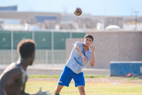 Junior quarterback, Marcos Lopez, practices at the Las Cruces High School football practice field in Las Cruces on Wednesday, July 24, 2019.