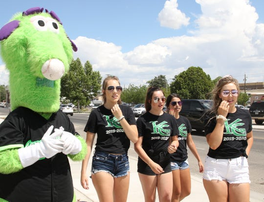 Mack, the Connie Mack World Series mascot, and members of the Farmington High School Kelly Greens dance team, welcome teams to the annual baseball tournament on July 24 at the Farmington Civic Center.