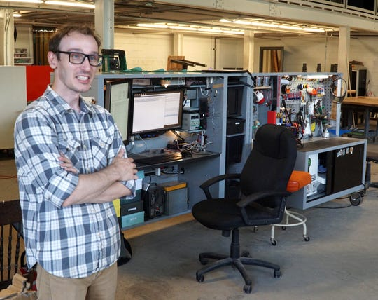 Dan Coats runs his small engineering firm Pulse Electronics from his Cubicle on Wheels (seen at right) at the Village Workshop.