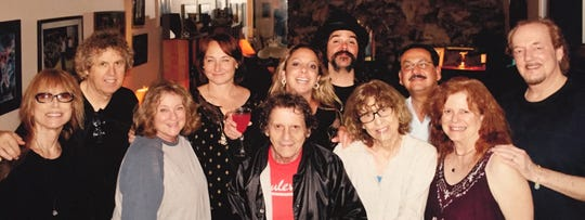From left, Ming C. Lowe, Bruce Fessier, Jane Fessier, Kate Franco, Paul Krassner, Zaina Alwan, Brant Bjork, Nancy Cain Krassner, Al Franco, Travis Miller, Chip Miller gather for a group shot at a 2015 Christmas season party at the Fessier home.
