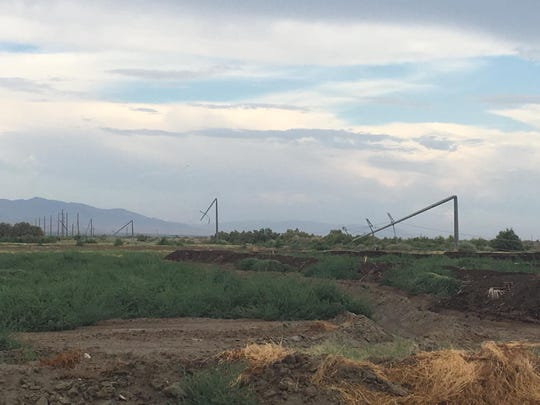 A Tuesday afternoon thunderstorm brought down power lines and poles in Thermal.
