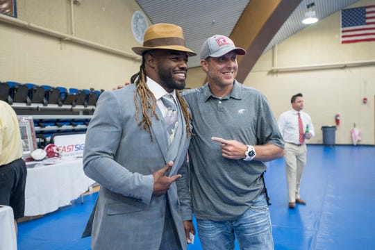 Trent Richardson, left, poses for a photo with a member during the Pensacola Bama Club scholarship kickoff event at Pensacola State College in Pensacola on Tuesday, July 23, 2019.