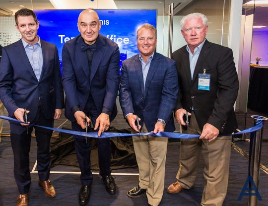 From left: Chris Camacho, president and CEO of the Greater Phoenix Economic Council; Acronis Executive Officer Serguei Beloussov; Tempe Mayor Mark Mitchell; and Kevin Sullivan, of the Arizona Commerce Authority, during a ribbon cutting marking the opening of Acronis' new office in Tempe.