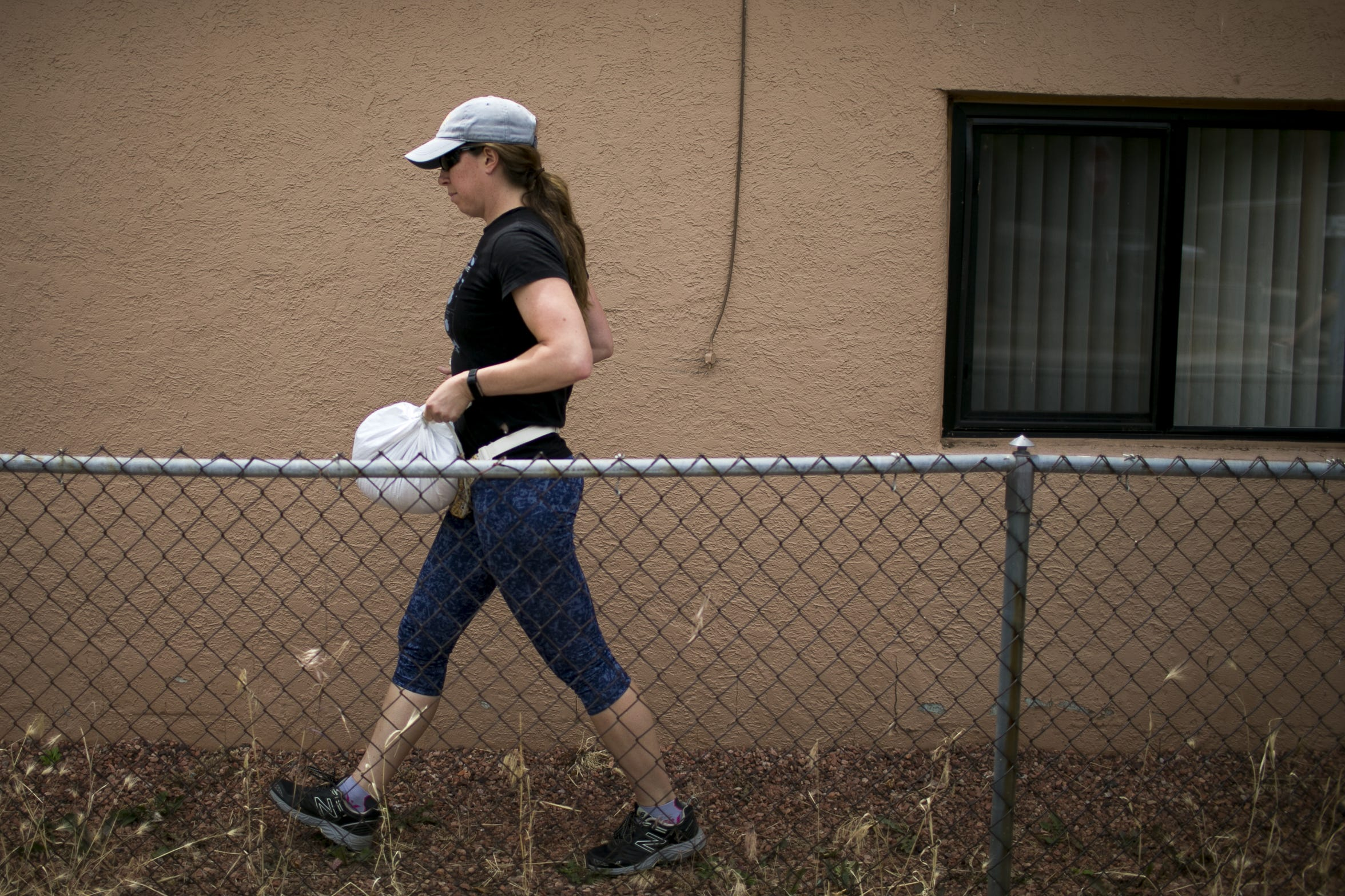 Elizabeth Vogler delivers sand bags to a home to help prepare for predicted flooding in Flagstaff on July 24, 2019. As the Museum Fire burned on in the mountains northwest of Flagstaff, residents in the Sunnyside community and nearby planned for flooding feared to be worsened in the monsoon season due to the fire.
