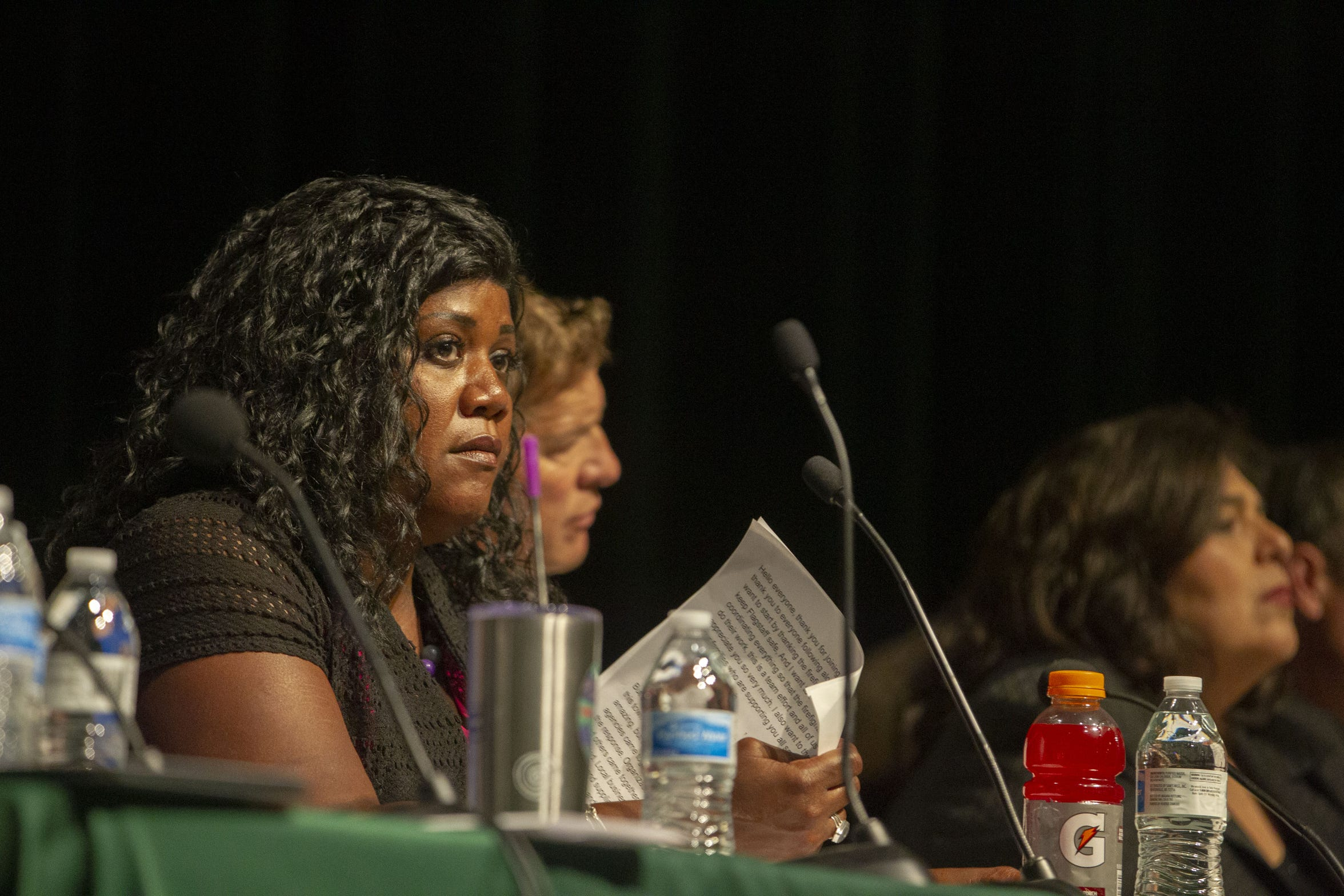 Flagstaff Mayor Coral Evans listens to a member of the audience share their concerns at a town meeting.