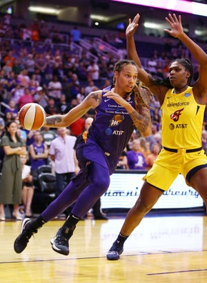 Phoenix Mercury center Brittney Griner moves a move to the basket against the Indiana Fever in the first half on July 23, 2019 in Phoenix, Ariz.