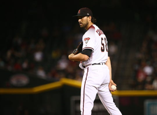 Arizona Diamondbacks pitcher Stefan Crichton throws to the Baltimore Orioles in the eighth inning at Chase Field on July 22, 2019 in Phoenix, Ariz.