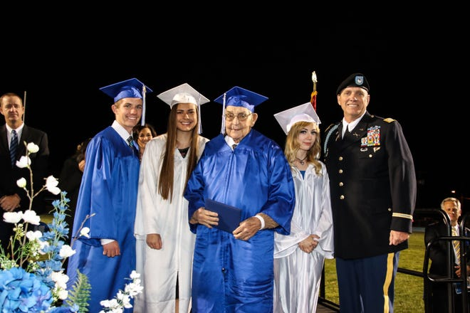 Charlie Hall received his high school diploma at age 96, along with three of his great-grandchildren, Tyler Hall, Daiziah McCray and Trinitee Flake, and accompanied by his son-in-law Jim Gill.