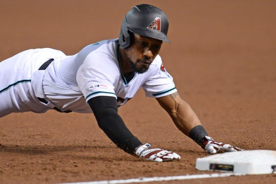 Jul 23, 2019; Phoenix, AZ, USA; Arizona Diamondbacks center fielder Jarrod Dyson (1) dives back into first base against the Baltimore Orioles during the first inning at Chase Field. Mandatory Credit: Joe Camporeale-USA TODAY Sports