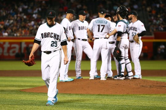 Diamondbacks right-hander Merrill Kelly served up three homers and recorded just seven outs before exiting in the third.