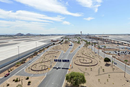 Xeriscaping, which uses native plants to conserve water, is expected to save Phoenix $400,000 annually and give Sky Harbor visitors a look at desert flora.