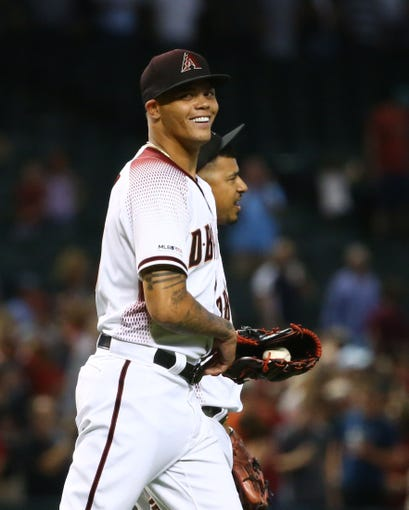 Arizona Diamondbacks pitcher 	Yoan Lopez picks-up his first career save against the Baltimore Orioles in the ninth inning at Chase Field on July 24, 2019 in Phoenix, Ariz.