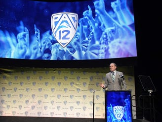 Pac-12 Commissioner Larry Scott speaks during Pac-12 football media day at Hollywood & Highland.