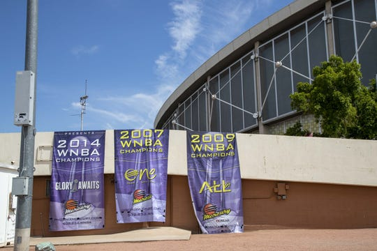 Three Phoenix Mercury WNBA championship banners are displayed outside of Veterans Memorial Coliseum on July 24.