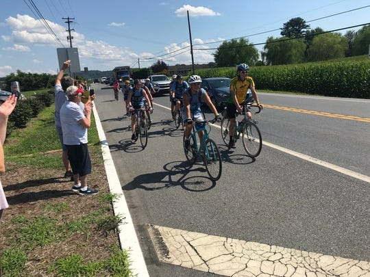 The JettRiders make their way down State Drive during their stop in South Lebanon on Wednesday afternoon. The group, which includes South Lebanon teenagers Luke and Lance Hains, is in the midst of a 700-mile bike trek to raise funds and awareness in the fight against Duchenne Muscular Dystrophy.