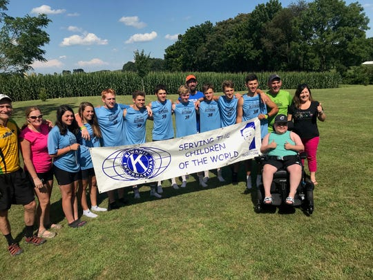 The Jett Riders and their supporters, including 12-year old Levi Hains of South Lebanon, pose for a picture at the Hains home  last summer during a break from their 700-mile bike trek to fight Duchenne Muscular Dystrophy.