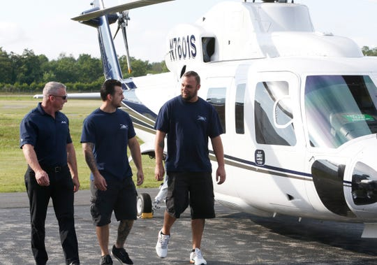 From left, Associated Aircraft Group pilot Mike Wright, with aircraft technicians, Nick Pacifico and Thomas Lewis at Hudson Valley Regional Airport on July 24, 2019. While on a test flight in the Sikorsky S-76 pictured Wright discovered the aircraft that crashed near the airport on Friday. Lewis and Pacifico stayed with the injured occupants until first responders arrived.