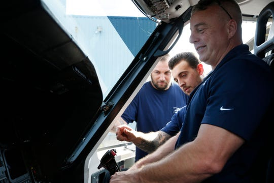 From left, Associated Aircraft Group aircraft technicians, Thomas Lewis and Nick Pacifico with pilot Mike Wright at Hudson Valley Regional Airport on July 24, 2019. While on a test flight in the Sikorsky S-76 pictured Wright discovered the aircraft that crashed near the airport on Friday. Lewis and Pacifico stayed with the injured occupants until first responders arrived.